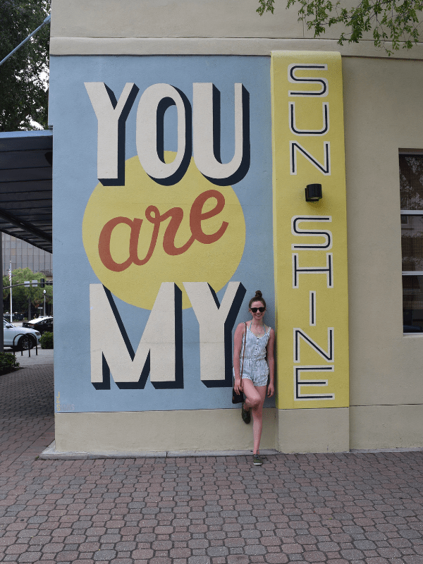 Posing in front of a mural in St. Petersburg, Florida