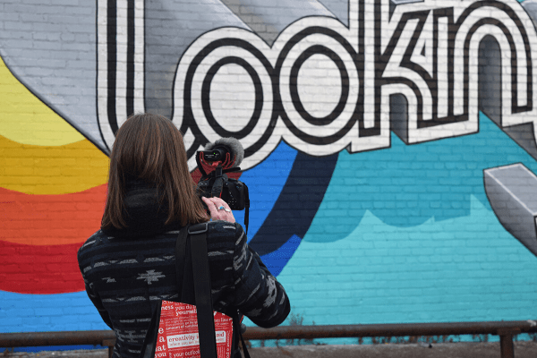 Julia Jornsay-Silverberg vlogging in front of Lookin' Good by Casey William Milbrand