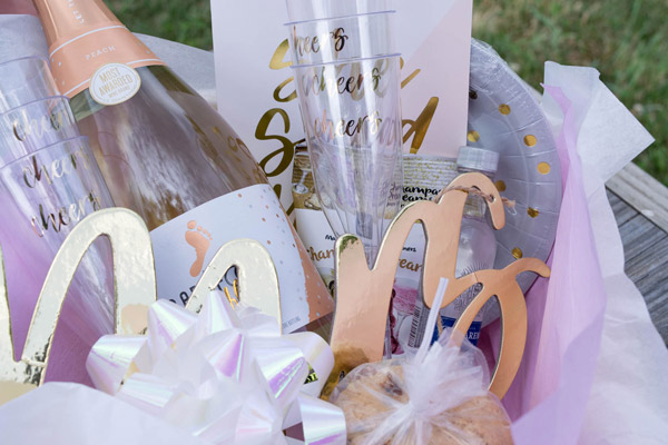 Basket filled with champagne and other gifts